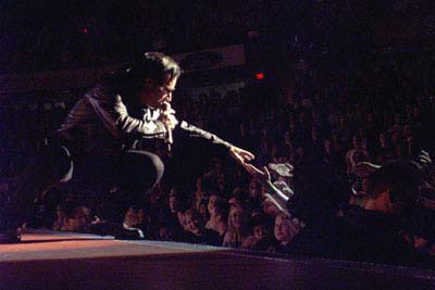 Bono reaches out to the fans during U2's concert Monday, April 9 at the Saddledome (Darren Makowichuk, Calgary Sun).