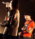 Bono (left) sings
