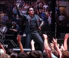 Lead singer and sometimes guitarist Bono does a little jig for the crowds at the June 5 Fleetcenter show. (AP Photo)