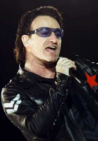 "Bono, lead singer for the rock group ""U2,"" performs during a concert in New York's Madison Square Garden, June 17, 2001. The band is nearing the end of it's North American tour and will be starting a European swing in early July. REUTERS/Jeff Christensen"