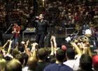 Bono, center, and The Edge, right, and Larry Mullen, Jr., on drums, perform during the U2 concert at Continental Airlines Arena Friday, June 22, 2001, in East Rutherford, N.J. The show was the last performance of the North American leg of the 2001 Elevation tour. (AP Photo/Bill Kostroun)