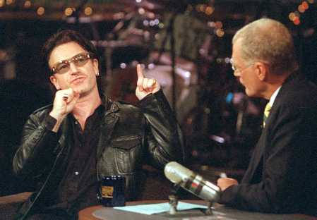 Show host David Letterman listens as U2's Bono, left, talks about his performance at Madison Square Garden during his appearance on CBS's Late Show with David Letterman, Monday, Oct. 29, 2001, in New York. (AP Photo/CBS, John Filo)