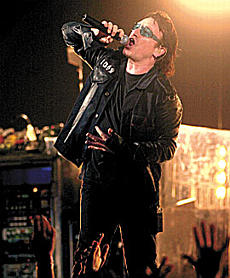 The rock band U2, led by singer Bono, performed ''Beautiful Day'' as the group's ''Elevation'' tour stopped at Kemper Arena on Tuesday. Although it was U2's first concert in Kansas City since 1997, it fell short of selling out. <br />Photo Whitney Curtis / The Kansas City Star