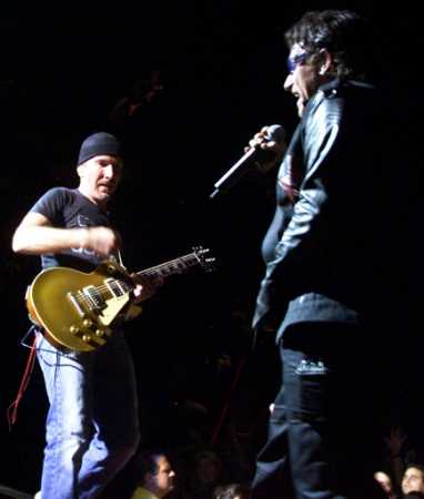 U2's 'The Edge' (L) and 'Bono' perform in Miami during the group's final concert of their 'Elevation Tour,' December 2, 2001. U2 performed 113 concerts in its run through North America. (Colin Braley/Reuters)