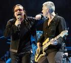 Bono, left, and Adam Clayton of U2 perform in Los Angeles, Tuesday, April 5, 2005. (AP Photo/Chris Pizzello)