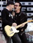 Lead singer Bono (R) and the Edge of Irish rock band U2 perform during concert at the City of Manchester Stadium June 14, 2005. U2 are currently on their 'Vertigo 2005' world tour. REUTERS/Darren Staples