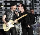 Irish band U2 vocalist Bono (R) and guitarist The Edge perform during the band's concert in Switzerland at the Letzigrund stadium in Zurich, July 18, 2005. REUTERS/Siggi Bucher