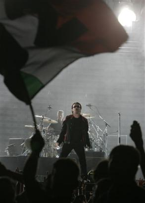 Singer Bono of the Irish rock group U2 performs on the stage during their Vertigo 2005 Tour at Rome's Olympis stadium, Italy, Saturday, July 23, 2005. (AP Photo/Pier Paolo Cito)