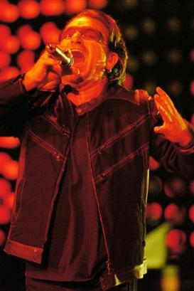 U2's Bono performs during the band's concert in Toronto, Monday, Sept. 12, 2005. (AP PHOTO/CP, Aaron Harris)