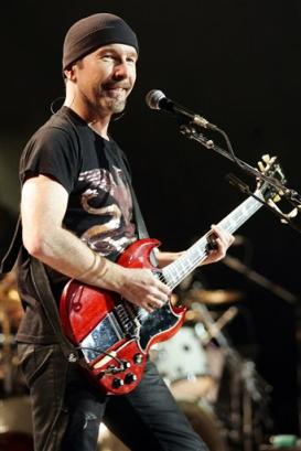 U2 guitarist The Edge performs during the Vertigo Tour at Madison Square Garden in New York, Nov. 21, 2005. (AP Photo/Jeff Christensen)