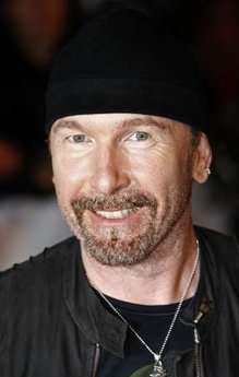 U2 guitarist The Edge poses for photographers as he arrives for the Brit Awards at Earls Court in London February 18, 2009. REUTERS/Luke MacGregor (BRITAIN)