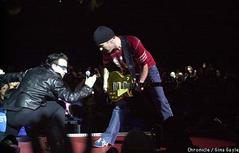 Bono and the Edge went for broke at the U2 show at Compaq Center in San Jose. San Francisco Chronicle photo by Gina Gayle