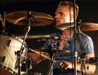 Drummer Larry Mullen, plays