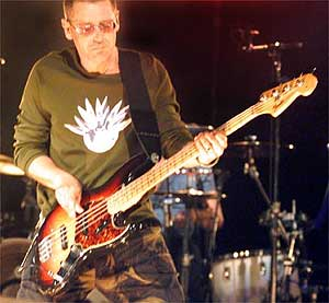 "U2's bassist Adam Clayton plays ""Until the End of the World"" on Saturday.<br />Deirdre Hamill/The Arizona Republic"