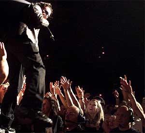 Bono works the crowd Saturday night at America West Arena.<br />Deirdre Hamill/The Arizona Republic<br />