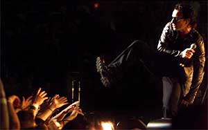 """Bono, sings """"Until the End of the World"""" to a sold out crowd.<br />Deirdre Hamill/The Arizona Republic"""