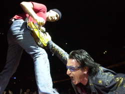 SHARON CANTILLON/Buffalo News <br />U2's Bono gets into some stage theatrics with the Edge, left, in HSBC Arena.