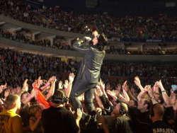 SHARON CANTILLON/Buffalo News <br />Bono interacts with an enthusiastic crowd at Thursday's concert.
