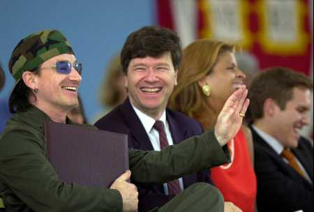 U2's Bono, left, laughs with Harvard economist Jeffrey D. Sachs, second left, and others after he received an honorary membership to the class of 2001 at Class Day ceremonies at Harvard University in Cambridge, Mass., Wednesday, June 6, 2001. (AP Photo/Elise Amendola)