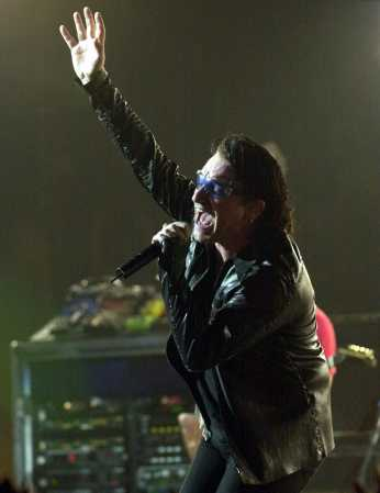 Bono, of U2, performs at the Continental Airlines Arena Friday, June 22, 2001, in East Rutherford, N.J. The show was the last performance of the North American leg of the 2001 Elevation tour. (AP Photo/Bill Kostroun)