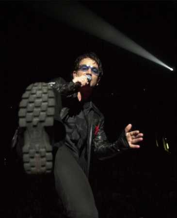Bono performs during the U2 concert at Continental Airlines Arena Friday, June 22, 2001, in East Rutherford, N.J. The show was the last performance of the North American leg of the 2001 Elevation tour. (AP Photo/Bill Kostroun)