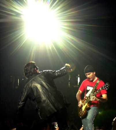 The Edge, right, performs with Bono during the U2 concert at Continental Airlines Arena Friday, June 22, 2001, in East Rutherford, N.J. the show was the last performance of the North American leg of the 2001 Elevation tour. (AP Photo/Bill Kostroun)