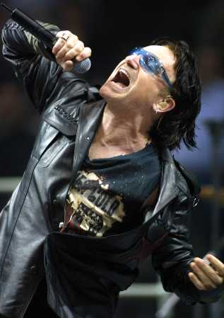 Bono, lead singer of U2, sings Elevation during their Elevation Tour 2001 at the Molson Center in Montreal, Quebec Friday Oct. 12, 2001. (AP Photo/CP, Andre Forget)