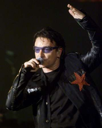 """Bono of the group U2 performs at the Baltimore Arena in Baltimore, Maryland October 19, 2001. Bono will be one of many performers at the """"Concert for New York City"""" to be held in New York on October 20. REUTERS/Molly Riley"""