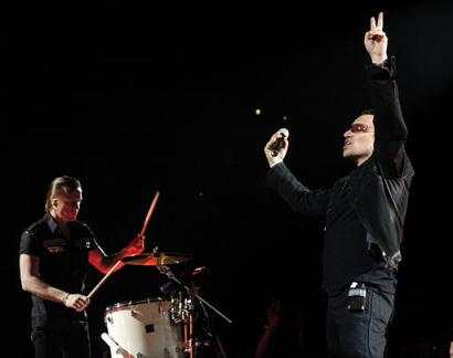 Bono, right, and Larry Mullen Jr. of U2 perform in Los Angeles, Tuesday, April 5, 2005. (AP Photo/Chris Pizzello)