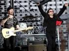 Irish band U2 vocalist Bono (R) and guitarist The Edge perform during the band's concert in Switzerland at the Letzigrund stadium in Zurich, July 18, 2005. REUTERS/Siggi Bucher