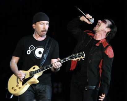Singer Bono, right, and lead guitarist The Edge of Irish group U2 perform on stage during their Vertigo 2005 Tour at the San Siro stadium in Milan, Italy, Wednesday, July, 20, 2005. (AP Photo/Luca Bruno)