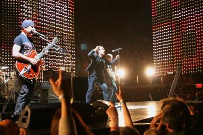U2's lead singer Bono, center and guitarist The Edge perform during the Vertigo Tour at Madison Square Garden in New York, Monday, Nov. 21, 2005. (AP Photo/Jeff Christensen)