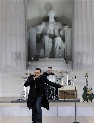 Bono performs with U2 during 'We Are One: Opening Inaugural Celebration at the Lincoln Memorial' in Washington, Sunday, Jan. 18, 2009. (AP Photo/Alex Brandon)