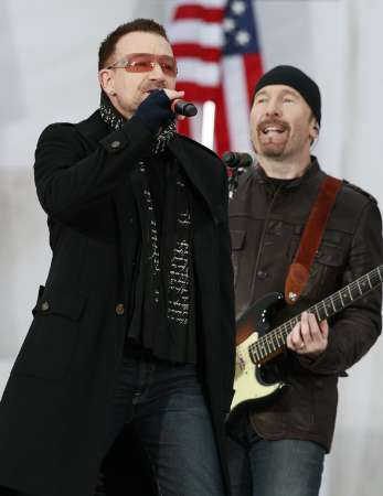 Bono (L) and The Edge of U2 perform 'In the Name of Love' during the We Are One: Inaugural Celebration at the Lincoln Memorial in Washington January 18, 2009. REUTERS/Jason Reed UNITED STATES)