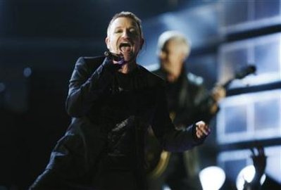 Lead singer Bono of the band U2 performs at the 51st annual Grammy Awards in Los Angeles February 8, 2009. (Lucy Nicholson/Reuters)