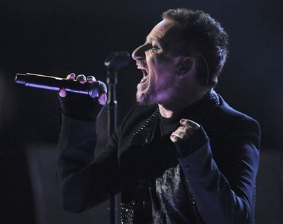 Bono, of the musical group U2, performs at the opening act of the 51st Annual Grammy Awards on Sunday, Feb. 8, 2009, in Los Angeles. (AP Photo/Mark J. Terrill)